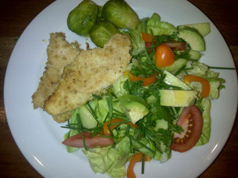 Crumbed chicken breasts, brussel sprouts and salad
