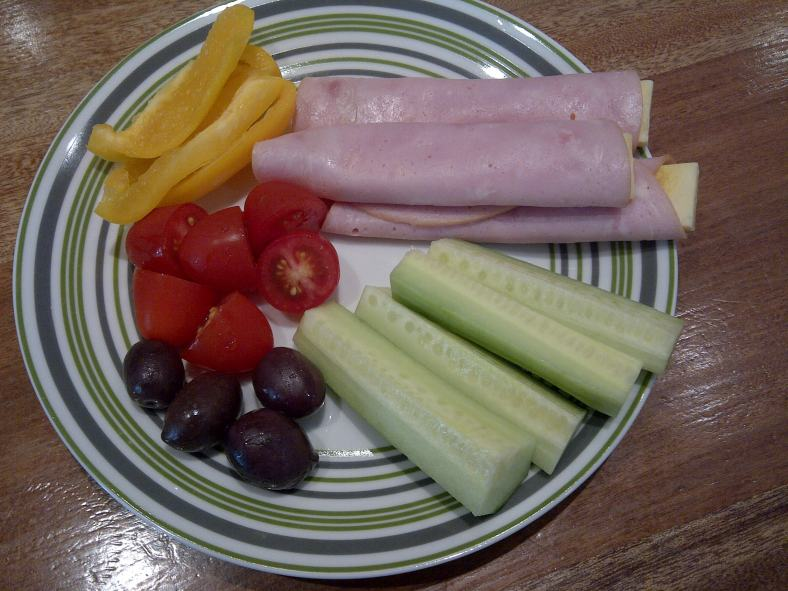 Lunch: Ham and cheese roll-ups, cucumber, tomatoes, yellow pepper and olives