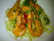 Garlic prawns served on stir-fried baby cabbage