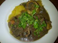 Springbok neck stew with marrow bones on top of gem squash
